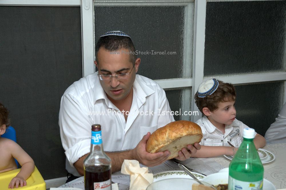 Jewish Rosh Hashana ceremony blessing the bread