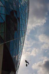 London, September 7th 2015. PICTURED: David Dangoor, representing the Exilarch Foundation descends from the top of 30 St Mary's Axe - The Gerkhin. The Outward Bound Trust City Three Peaks Challenge in conjunction with The Royal Navy and Royal Marines Charity is a breathtaking abseiling endeavour on the greatest urban mountain range: The City of London.