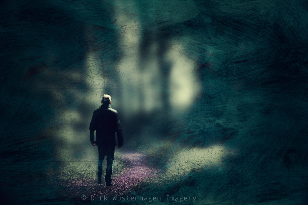 Man walking on a forest hike - abstraction of a photograph