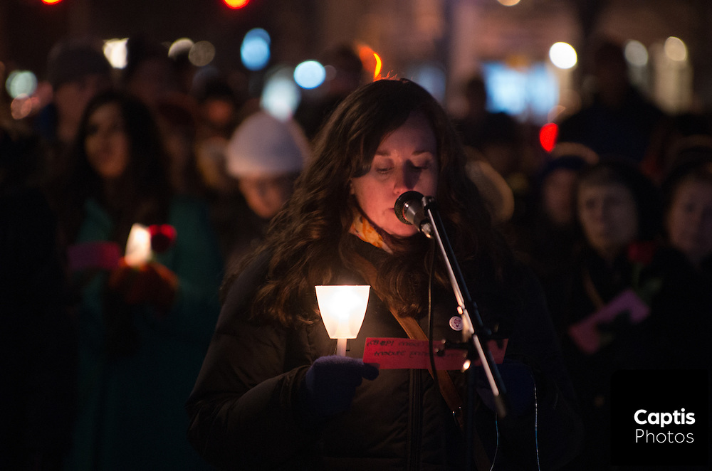 Women read the names of victims of violence against women. December 6, 2014.