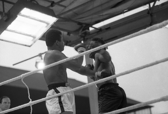 Ali vs Lewis Fight, Croke Park,Dublin..1972..19.07.1972..07.19.1972..19th July 1972..As part of his built up for a World Championship attempt against the current champion, 'Smokin' Joe Frazier,Muhammad Ali fought Al 'Blue' Lewis at Croke Park,Dublin,Ireland. Muhammad Ali won the fight with a TKO when the fight was stopped in the eleventh round...Image shows both fighters swinging wildly in trying to gain an advantage.