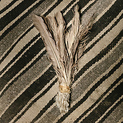 """A broom made of feathers. Camp at a Wakhi high pasture names """"Warm"""", below Garumdee Pass. Guiding and photographing Paul Salopek while trekking with 2 donkeys across the """"Roof of the World"""", through the Afghan Pamir and Hindukush mountains, into Pakistan and the Karakoram mountains of the Greater Western Himalaya."""