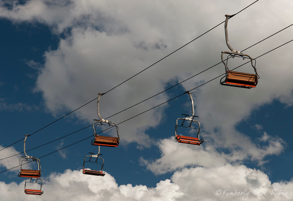 Looking up at an empty chairlift in summertime.