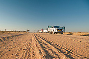 Jeep and  Land Rover safari travelling on a dirt track, Namibia