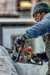 Carving An Ice Sculpture with A Chainsaw