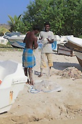 Men with fishing nets on tropical beach at Pasikudah Bay, Eastern Province, Sri Lanka, Asia