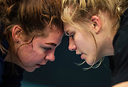 Bella Mitchell, left, and Kai Morrison run drills during a practice in Colorado Springs, Colorado. Mitchell has been wrestling since she was in the 6th grade and was the 2nd place champion in the 2018 state tournament.