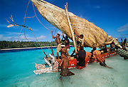 Outrigger sailing canoe, Kitava Island, Papua New Guinea.