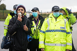 West Hyde, UK. 9th September, 2020. Hertfordshire Police officers invoke Section 14 of the Public Order Act 1986 to clear anti-HS2 activists from an area outside one of several entrances blocked by them to the Chiltern Tunnel South Portal site for the HS2 high-speed rail link for the entire day. The protest action, at the site from which HS2 Ltd intends to drill a 10-mile tunnel through the Chilterns, was intended to remind Prime Minister Boris Johnson that he committed to remove deforestation from supply chains and to provide legal protection for 30% of UK land for biodiversity by 2030 at the first UN Summit on Biodiversity on 30th September.