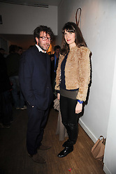 LADY SOPHIE HAMILTON and JOHNNY ? at a private view of Henry Brudenell-Bruce's work held at 269 Portobello Road, London, W14 on 24th November 2009.