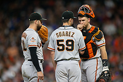 May 22, 2018 - Houston, TX, U.S. - HOUSTON, TX - MAY 22: San Francisco Giants starting pitcher Andrew Suarez (59) and catcher Buster Posey (28) third baseman Evan Longoria (10) meet at the mound in the third inning during an MLB baseball game between the Houston Astros and the San Francisco Giants on May 22, 2018 at Minute Maid Park in Houston, Texas. (Photo by Juan DeLeon/Icon Sportswire) (Credit Image: © Juan Deleon/Icon SMI via ZUMA Press)