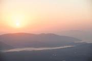 Foggy sunrise over mountain landscape, Plomari, Lesbos, Greece