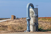 Groundwater well and standpipe for crop irrigation. Porterville, Tulare County, San Joaquin Valley, California, USA