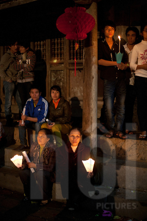 People gather in front of Phat Diem church to watch a ceremonial procession in celebration of Christmas, Ninh Binh Province, Vietnam, Southeast Asia