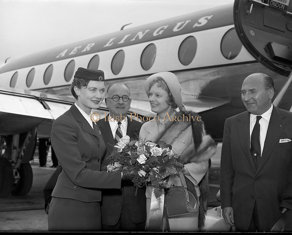 08/06/1957<br /> 06/08/1957<br /> 08 June 1957<br /> <br /> Herbert Wilcox (centre) and Anna Neagle are welcomed by an Air Lingus steward at Dublin Airport<br /> <br /> <br /> Dame Anna Neagle, DBE (20/10/1904 – 03/06/1986), born Florence Marjorie Robertson, was a popular British stage and motion picture actress and singer.<br />