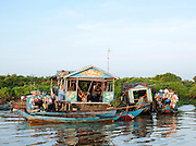 People live on boats in small village communities on the great Tonlé Sap lake, Cambodia