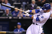 Kansas City Royals left fielder Alex Gordon (4) strokes a double down the right field line during Tuesday's baseball game, between the Kansas City Royals and the Chicago Whitesox at Kauffman Stadium in Kansas City, Missouri. The Royals defeated the Whitesox 7-6 in 12 innings.