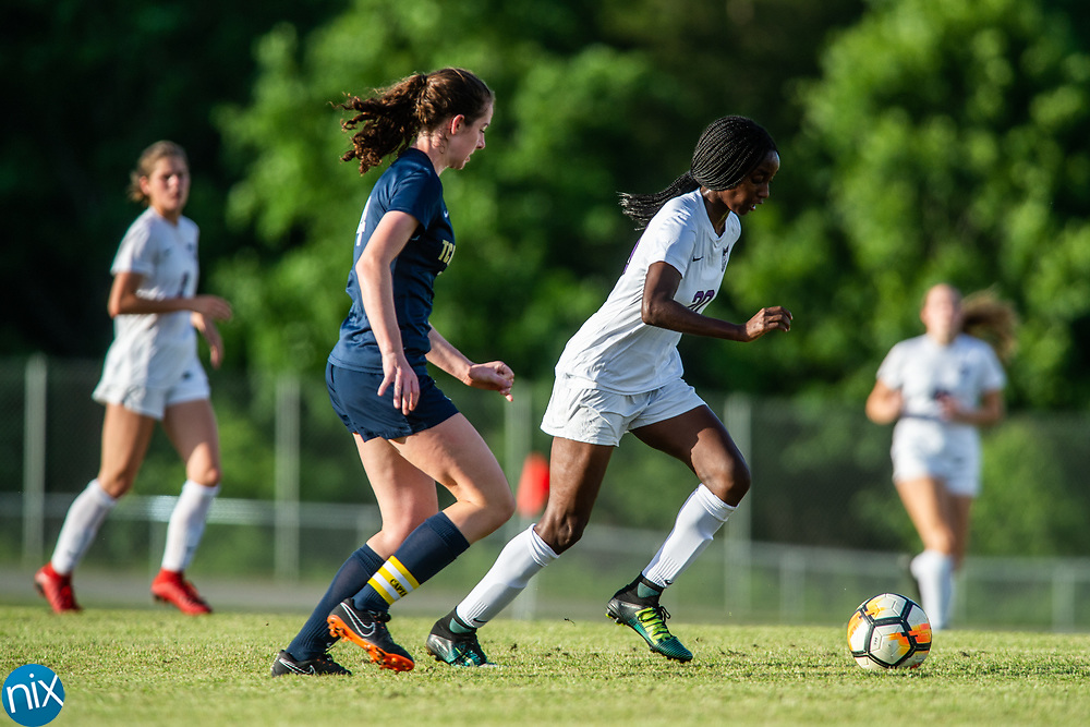 Cox Mill's Naomi Fountain (20) fights for the ball against TC Roberson during the regional finals of the NCHSAA Playoffs Tuesday, May 22, 2018. Cox Mill won 3-1 in overtime to advance to the state championship game.