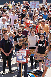 June 17, 2017 - Leeds, United Kingdom - Young people protesting at a rally in Leeds against the Conservative Party (Tories) and Democratic Unionist Party (DUP) relationship and for the victims of the Grenfell Tower fire Demonstration against the Conservative Party and Democratic Unionist Party (DUP) and for the victims of the Grenfell Tower fire, Leeds, UK - 17 Jun 2017 (Credit Image: © RMV via ZUMA Press)