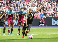Football - 2019 / 2020 Premier League - West Ham United vs. Manchester City<br /> <br /> Sergio Aguero (Manchester City) prepares to strike the penalty that gives his team a 4-0 lead at the London Stadium<br /> <br /> COLORSPORT/DANIEL BEARHAM