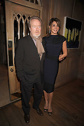 RIDLEY SCOTT and GIANNINA FACIO at a party to celebrate the launch of Hollywood Domino - a brand new board game, held at Mosimann's 11b West Halkin Street, London on 7th November 2008.  The evening was in aid of Charlize Theron's Africa Outreach Project.