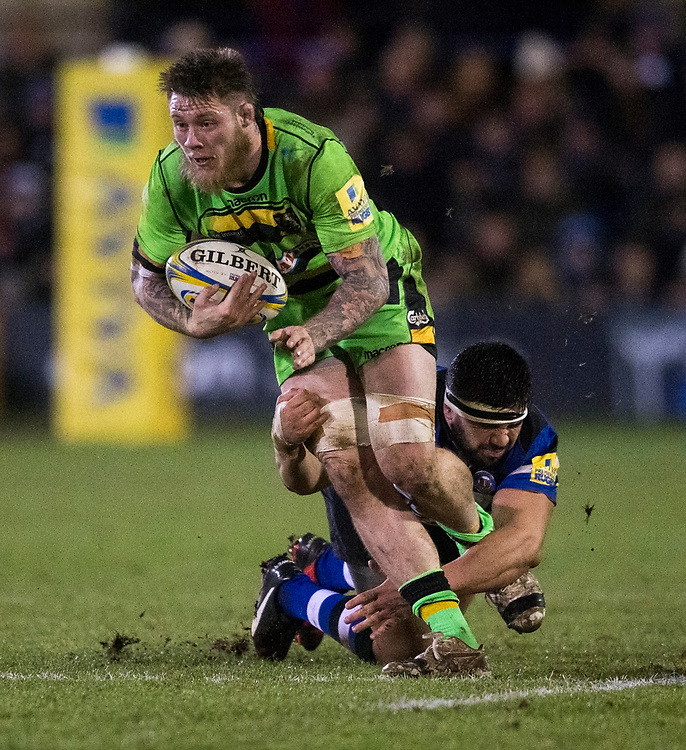 Northampton Saints' Teimana Harrison is tackled by Bath Rugby's Lucas Noguera Paz<br /> <br /> Photographer Bob Bradford/CameraSport<br /> <br /> Aviva Premiership - Bath Rugby v Northampton Saints - Friday 9th February 2018 - The Recreation Ground - Bath<br /> <br /> World Copyright © 2018 CameraSport. All rights reserved. 43 Linden Ave. Countesthorpe. Leicester. England. LE8 5PG - Tel: +44 (0) 116 277 4147 - admin@camerasport.com - www.camerasport.com
