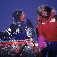Will Steger & Julie Hanson mush through fog at midnight on Arctic Ocean.