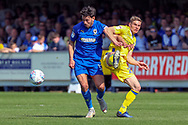 AFC Wimbledon defender Will Nightingale (5) battles for possession during the EFL Sky Bet League 1 match between AFC Wimbledon and Bristol Rovers at the Cherry Red Records Stadium, Kingston, England on 19 April 2019.