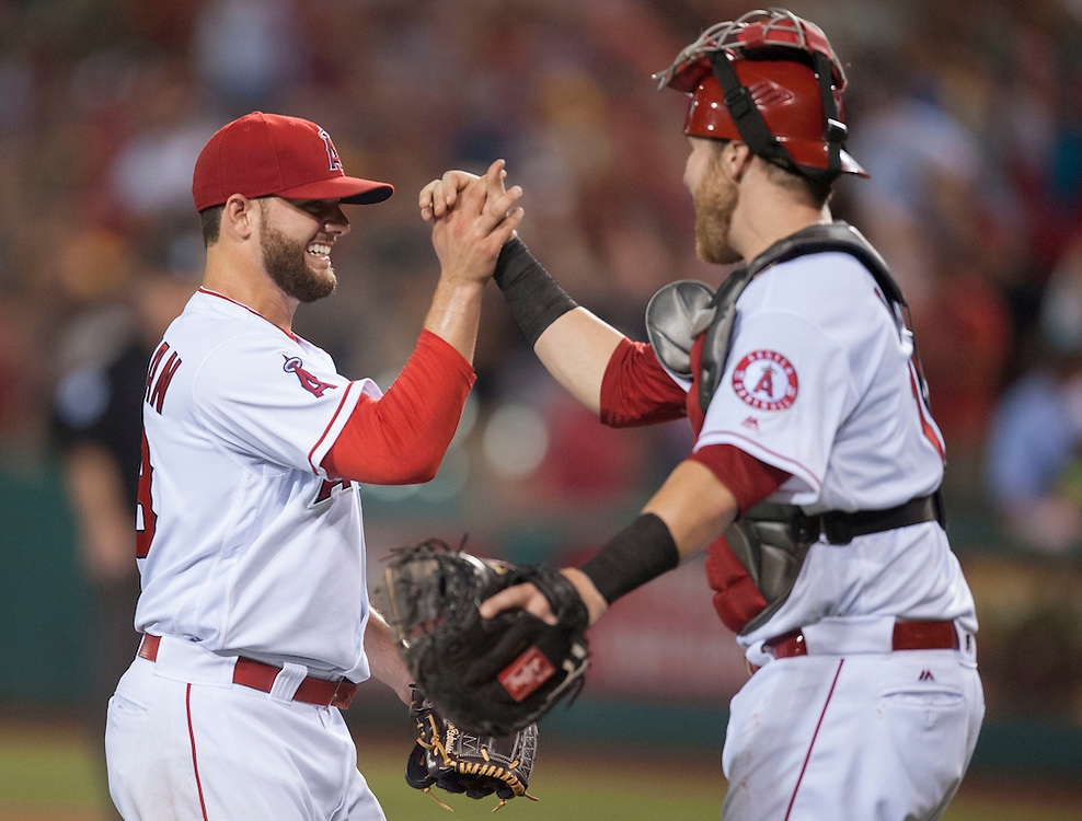 Reliever Cam Bedrosian celebrates with catcher Jett Bandy after picking up his first career save during the Angels' 5-4 victory over the Oakland Athletics at Angel Stadium on Tuesday.<br /> <br /> ///ADDITIONAL INFO:   <br /> <br /> angels.0803.kjs  ---  Photo by KEVIN SULLIVAN / Orange County Register  -- 8/2/16<br /> <br /> The Los Angeles Angels take on the Oakland Athletics at Angel Stadium.