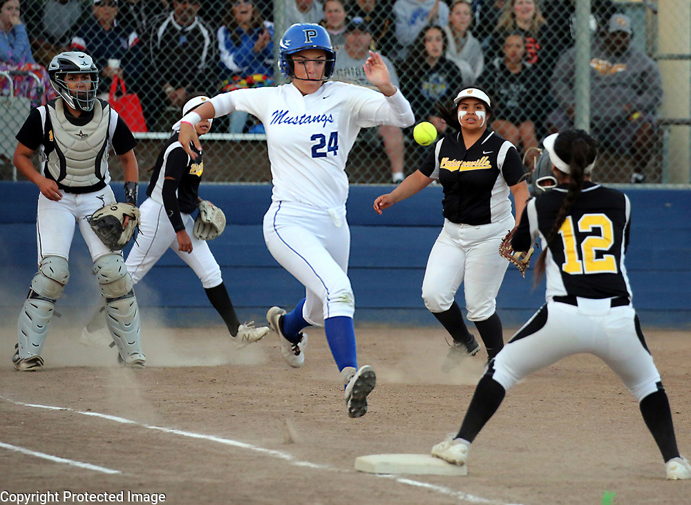 Pioneer High School's Holly Azevedo goes all out trying to bunt her way on as Watsonville second baseman Liyah Lopez covers first to make the put out during Watsonville's 10-inning Central Coast Section semi-final game at PAL Stadium in San Jose, California on Thursday May 25, 2017. Watsonville won the game 0-0 by tie-breaker rule to advance to the section championship, where they defeated Homestead to win the first-ever Santa Cruz County CCS softball title.<br /> Photo by Shmuel Thaler <br /> shmuel_thaler@yahoo.com www.shmuelthaler.com