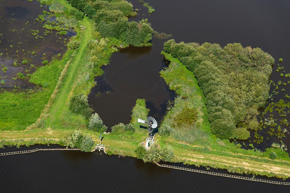 Nederland, Groningen, 27-08-2013; Foxholsterneer, met de poldermolen Koetze Tibbe. <br /> De windmolen is een Amerikaanse windmotor (ook: roosmolen),  en wordt gebruikt voor de bemaling van de polder.<br /> American wind engine, used for pumping surplus water from small polder.<br /> aerial photo (additional fee required);<br /> copyright foto/photo Siebe Swart.