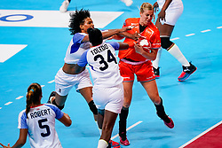 03-12-2019 JAP: Netherlands - Cuba, Kumamoto<br /> Third match 24th IHF Women's Handball World Championship, Netherlands win the third match against Cuba with 51- 23. / Danick Snelder #10 of Netherlands, Yunisleidy Camejo Rodriguez #11 of Cuba, Yennifer Amanda Toledo Abreu #34 of Cuba