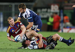 Kendrick Lynn is tackled by Deon Fourie and De Kock Steenkamp during the Super Rugby (Super 15) fixture between the DHL Stormers and the Highlanders held at DHL Newlands Stadium in Cape Town, South Africa on 11 March 2011. Photo by Jacques Rossouw/SPORTZPICS