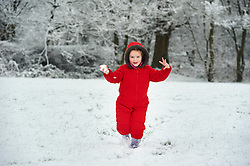 © Licensed to London News Pictures. 17.01.16 London, UK. As snow hit the south east of the UK overnight Isla James, 6 plays snowballs in a park in Shenley, Hertfordshire.. Photo credit : Simon Jacobs/LNP