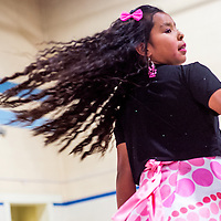 070513       Cable Hoover<br /> <br /> Chantel Yazzie's locks fly out as she spins for the crowd during the 3rd annual Boys and Girls Club fashion show at the Boys and Girls Club in Gallup Friday.