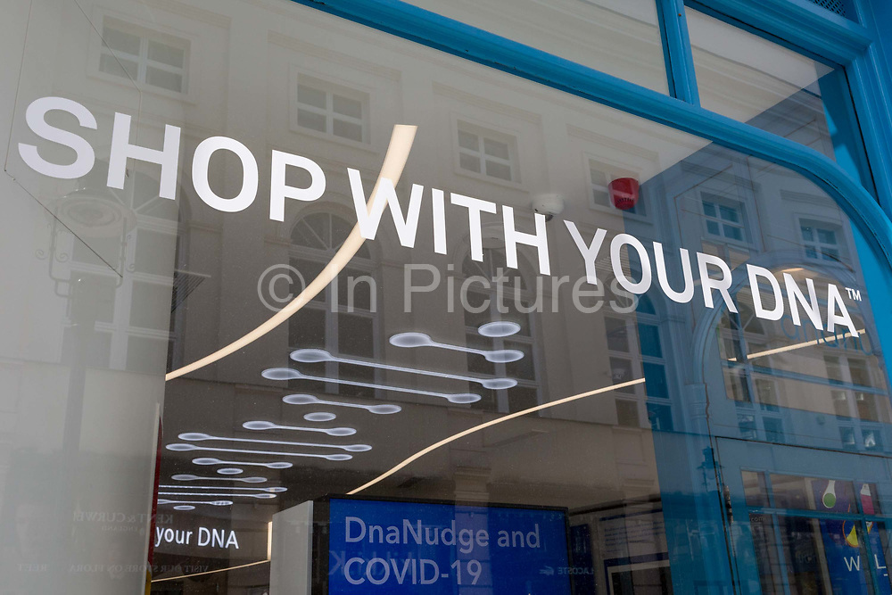 """An exterior of DnaNudges flagship store window in Covent Garden, seen during the UKs Coronavirus pandemic lockdown period, on 26th May 2020, in London, England. DnaNudge is the world's first service to use ones own DNA and lifestyle factor to nudge towards healthier choices. Following a quick and simple instore DNA test, consumers can start using a DnaBand to scan product barcodes and discover whether a food product is """"red"""" or """"green"""" for you. If the product is indicated as """"green"""", it is a good choice but if its red, the App will display a range of personalised recommended alternatives generated by science-led analytics."""