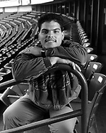 "Texas Ranger catcher Ivan ""Pudge"" Rodriguez poses for a portrait at Arlington Stadium in Arlington Texas.  (Photo by Ron Vesely)."
