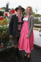 06.10.2013, Kaefers Wiesenschaenke, Muenchen, GER, der FC Bayern Muenchen beim Oktoberfest, im Bild Philipp Lahm of Bayern Muenchen poses with his wife Claudia Lahm in front of the ensemble of the Bavaria statue, a monumental bronze sand-cast 19th-century statue and the Hall of Fame (Ruhmeshalle). The Bavaria is the female personification of the Bavarian homeland and by extension its strength and glory // during the Oktoberfest 2013 beer festival at Kaefers Wiesenschaenke in Munich, Germany on 2013/10/06. EXPA Pictures © 2013, PhotoCredit: EXPA/ Eibner/ Eckhard Eibner<br /> <br /> ***** ATTENTION - OUT OF GER *****