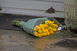 © Licensed to London News Pictures 22/10/2021.<br /> Woolwich, UK, Flowers left at the scene. A murder investigation has been launch by police after a man was found collapsed in Woolwich, South East London on Thursday 21st. The man was pronounced dead at the scene a large crime scene is in place which is causing traffic problems in the area. Photo credit:Grant Falvey/LNP