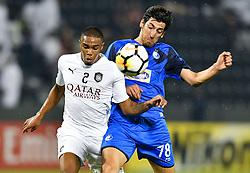 Pedro Ro-Ro (L) of Al Sadd vies for the ball with Morteza Tabrizi (R) of Esteghlal FC during the AFC Asian Champions League quarter-final second legs football match between Qatar's Al Sadd and Iran's Esteghlal FC at Jassim Bin Hamad Stadium Doha, Capital of Qatar, September 17, 2018. Al Sadd qualifying the semi-finals after a 2-2 draw in the second leg of their quarter-final clash with Esteghlal FC gave them a 5-3 aggregate win  (Credit Image: © Nikku/Xinhua via ZUMA Wire)