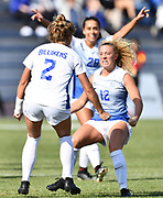 St. Louis University defender Brionna Halverson (right) runs up to teammate Alli Klug to congratulate Klug after she scored the second goal for SLU on a penalty kick inside the goal box. St. Louis University defeated George Washington in the championship game of the Atlantic 10 Conference Women's Soccer Tournament at Robert Hermann Stadium at St. Louis University on Sunday November 10, 2019.<br /> Photon by Tim Vizer