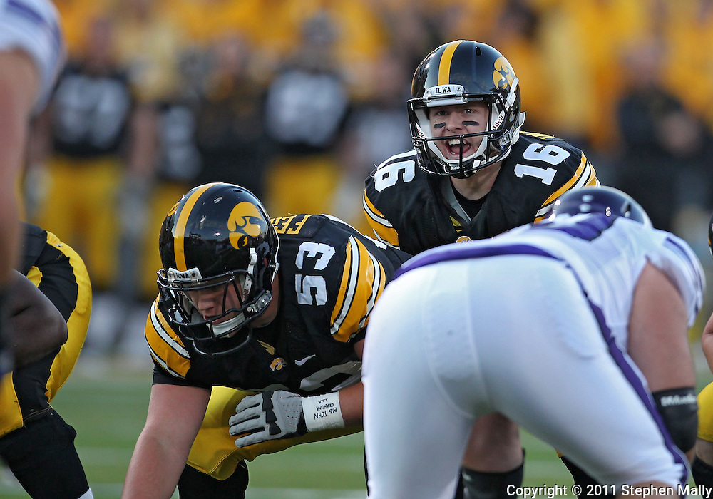 October 15, 2011: Iowa Hawkeyes quarterback James Vandenberg (16) yells out under center during the first half of the NCAA football game between the Northwestern Wildcats and the Iowa Hawkeyes at Kinnick Stadium in Iowa City, Iowa on Saturday, October 15, 2011. Iowa defeated Northwestern 41-31.
