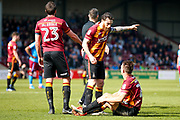 Bradford City Captain and midfielder Romain Vincelot (6)  has a word with Bradford City defender Anthony McMahon (29) during the EFL Sky Bet League 1 match between Scunthorpe United and Bradford City at Glanford Park, Scunthorpe, England on 26 March 2017. Photo by Simon Davies.