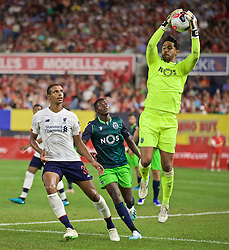 NEW YORK, NEW YORK, USA - Wednesday, July 24, 2019: Liverpool's Joel Matip and Sporting CP's goalkeeper Renan Ribeiro during a friendly match between Liverpool FC and Sporting Clube de Portugal at the Yankee Stadium on day nine of the club's pre-season tour of America. (Pic by David Rawcliffe/Propaganda)