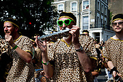 Notting Hill Carnival August 28th 2017. West London, England. Male musicians wearing leopard skin print tops parading with the London School of Samba.