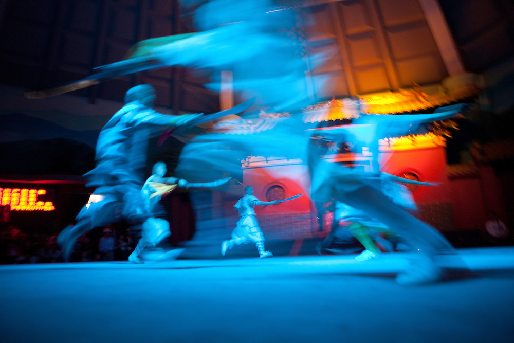Shaolin monks perform on stage.