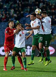 Vasil Bozhikov (2R) and Nikolay Bodurov (R) of Bulgaria  in action against Marko Jankovic (not seen) of Montenegro during the EURO 2020 UEFA Qualifier Group A match between Bulgaria and Montenegro at The Vasil Levski Stadium in Sofia, Bulgaria, 22 March 2019.