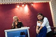 Jaqueline Romero abraza a su hijo Manuel Alejandro mientras su madrina, Nilda Marquez (i) da testimonio durante una misa cristiana del milagro que recibió su hijo. Gracias a FundaHigado, en junio de 2012, recibió un trasplante de higado que le permite disfrutar de la vida. Maracaibo, Venezuela 20 y 21 Oct. 2012. (Foto/ivan gonzalez)