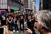 New York, NY - April 16, 2017. A group of people wear I Love New York T-shirts, and hats that represent landmarks, including the Staten Island Ferry (bearing marshmallow peeps), the Empire State Building, the Bronx Zoo, and the Brooklyn Bridge.