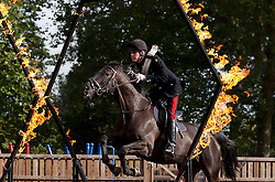 © Licensed to London News Pictures. 12/09/2012. LONDON, UK. Household Cavalry Lance Corporal of Horse Josh Tate jumps through a flaming ring on his horse Evolution in Hyde Park London today (12/09/12) during a taster of some of the acts taking part in the 2012 British Military Tournament. The theme of this year's tournament, involving all arms of the British military, is the life and times of Her Majesty the Queen and takes place at Earls Court in London on the 8th and 9th of December. Photo credit: Matt Cetti-Roberts/LNP